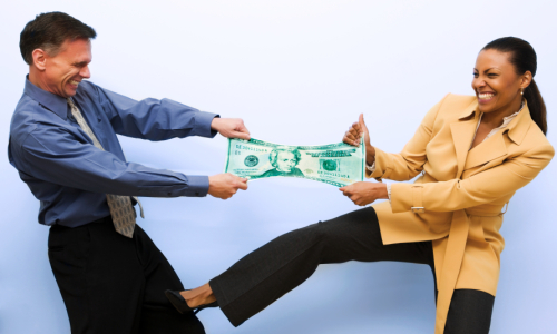 Business man and woman fighting over cash