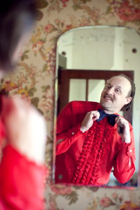 Goofy Looking Man Represents Prestige Seekers Attempting to Lead in Vain