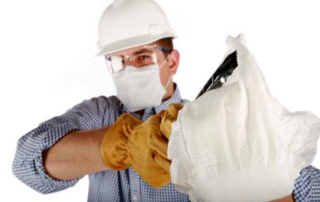 Man Changing Diaper in Hard Hat, Gloves and Tongs