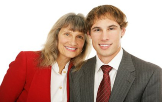 An Older Business Woman Mentor with a Younger Businessman Mentee
