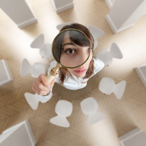 Woman Looking at Ceiling with Magnifying Glass