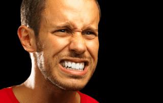 Man Grimaces at Feedback