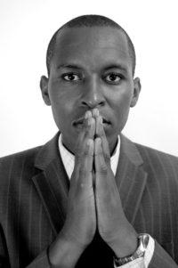 African American Businessman Praying or Begging or Pleading