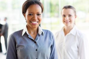 African businesswoman standing in front of colleague