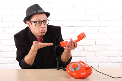 Young man talking on a vintage telephone, nice emotion