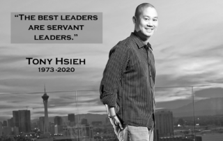 "Tony Hsieh standing on rooftop in black and white with his quote ""The Best Leaders are Servant Leaders"", his name and the years 1973 to 2020"